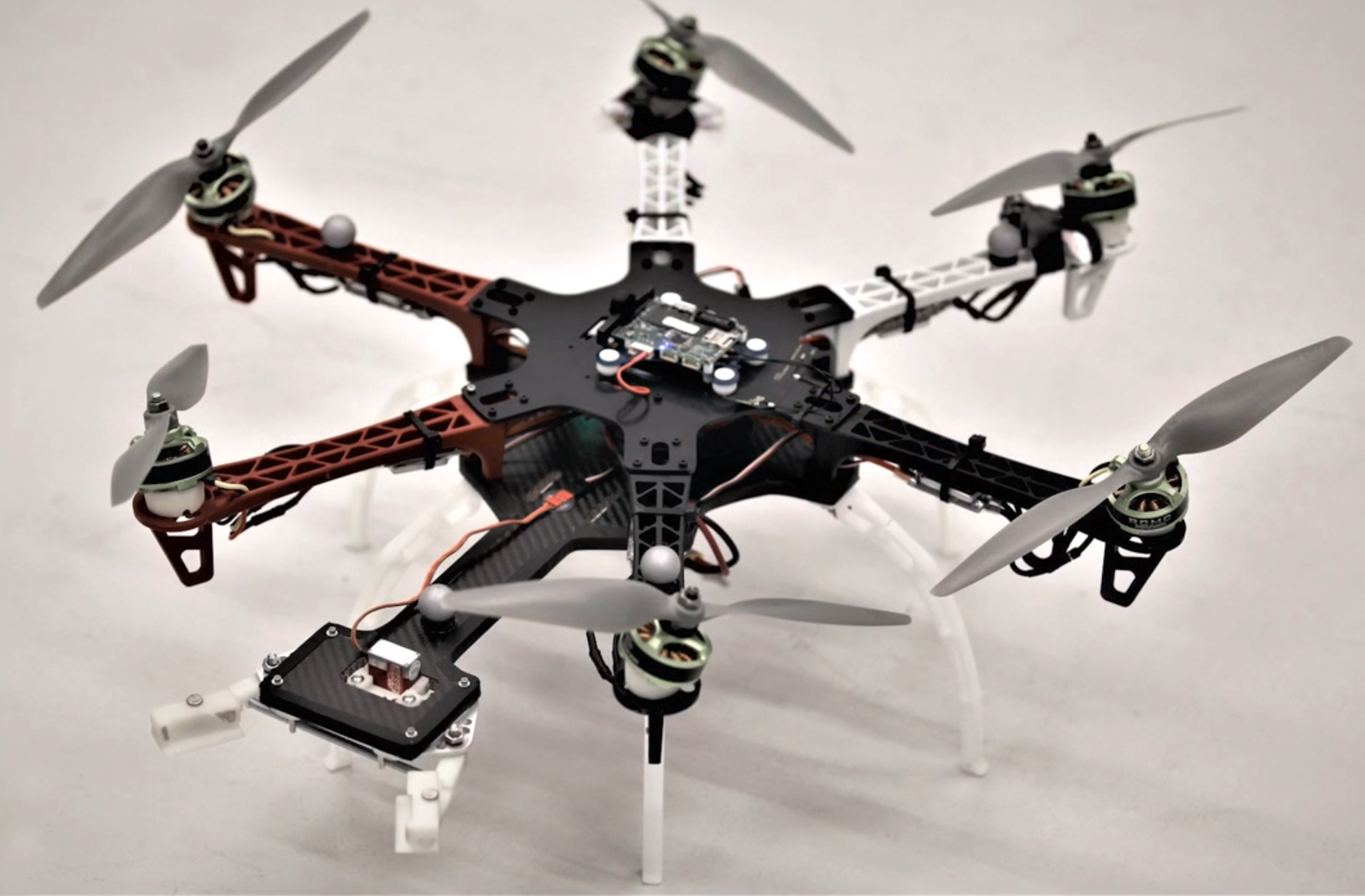 Agile Plate Transport with a Hexacopter with Canted Motors